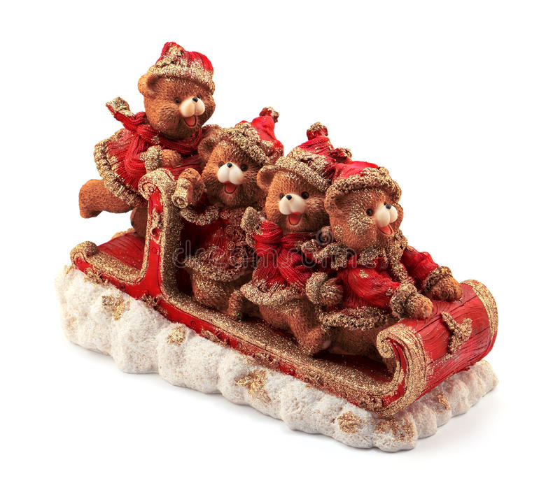 Handmade Christmas bears in sleigh in red and gold jackets and hats on snow isolated. On white royalty free stock photos