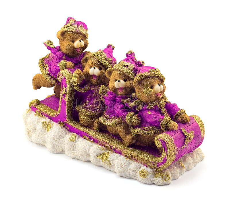 Handmade Christmas bears in sleigh in violet and gold jackets and hats on snow isolated. On white royalty free stock photography