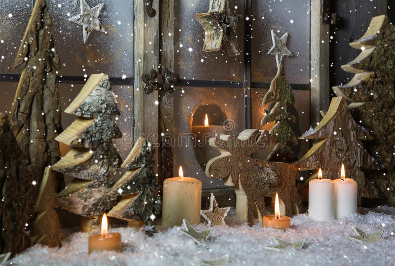 Handmade christmas decoration with wooden trees and reindeer. royalty free stock images