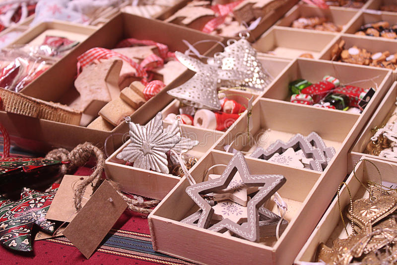 Handmade Christmas decorations exposed on advent market stall. Handmade Christmas decorations exposed in wooden boxes on advent market stall stock photography