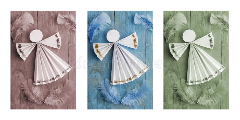 Handmade Christmas decorations,paper angel on wooden background. Triptych. In brown,blue and green stock images