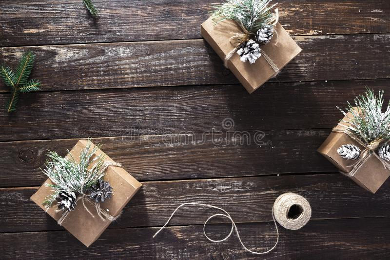 Handmade Christmas Gift Boxes dark wooden background top view flat lay royalty free stock photo