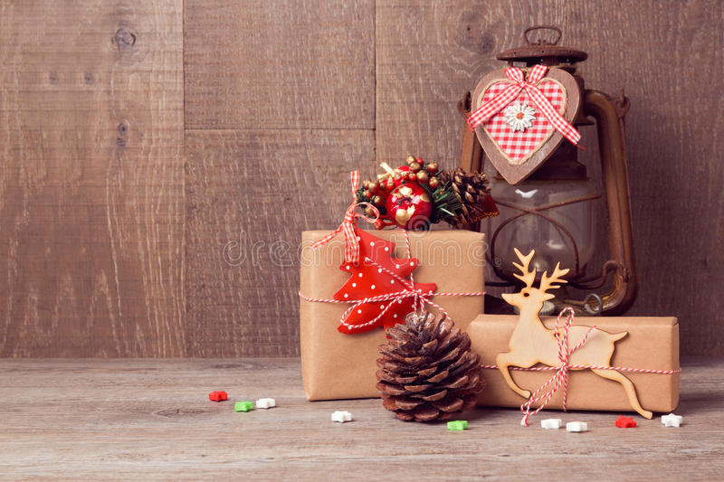 Handmade Christmas gifts with vintage lantern on wooden table stock photography