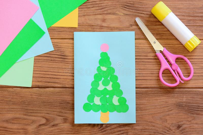 Cute Christmas tree card. Christmas greeting card, colored paper, scissors, glue stick on a wooden table. Creative idea. Handmade Christmas greeting card royalty free stock photos