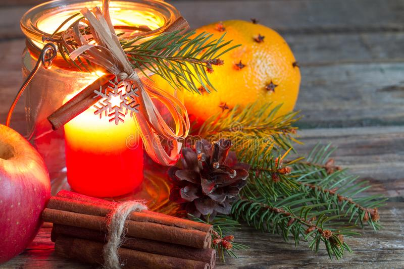 Handmade christmas organic ornament with candle on old retro wooden table with orange and tree. Closeup stock image