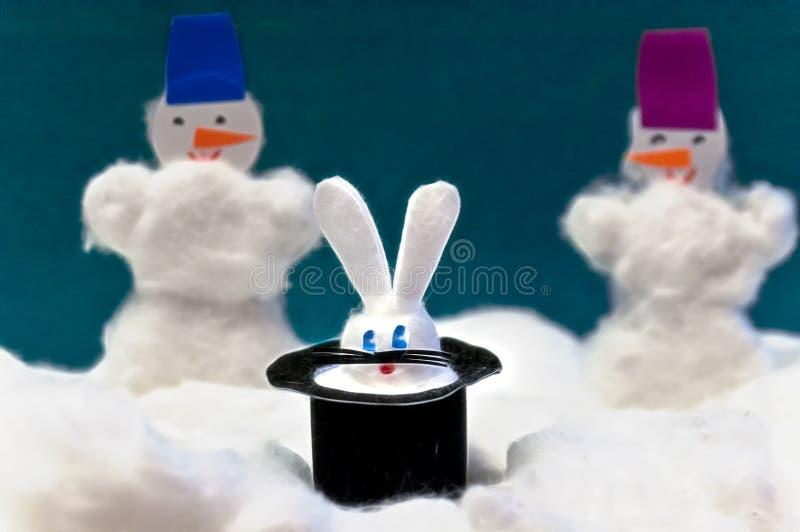 Handmade Christmas rabbit and two snowmans. Handmade Christmas focus rabbit in magician hat, and two snowmans stock photos