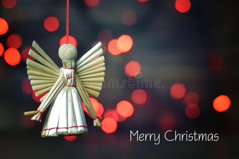 Merry Christmas card. Handmade Christmas straw ornament. Christmas angel royalty free stock photos