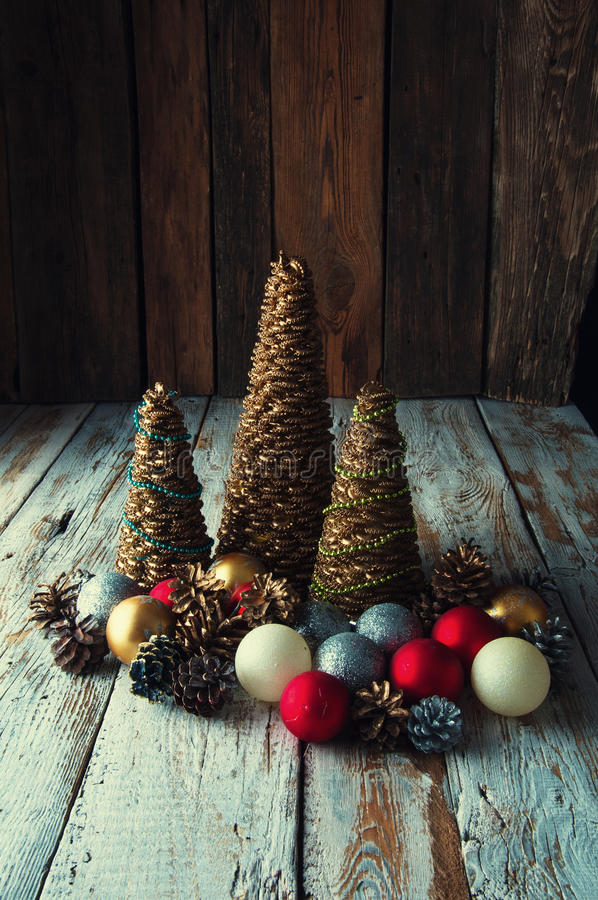Handmade Christmas trees with cones and christmas decorations royalty free stock photo