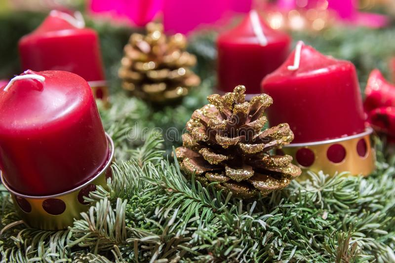 Handmade Christmas wreaths from fresh green fir tree branches decorated with red candles in rustic style at holiday market royalty free stock photography