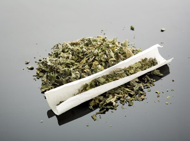 Handmade cigarette. With dried marijuana royalty free stock image