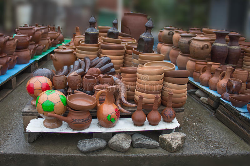 Handmade clay pots, jars, drinking horn. Ceramic plates. Handmade clay pots, jars, drinking horn. Ceramic ware with jugs, plates and cups stock image