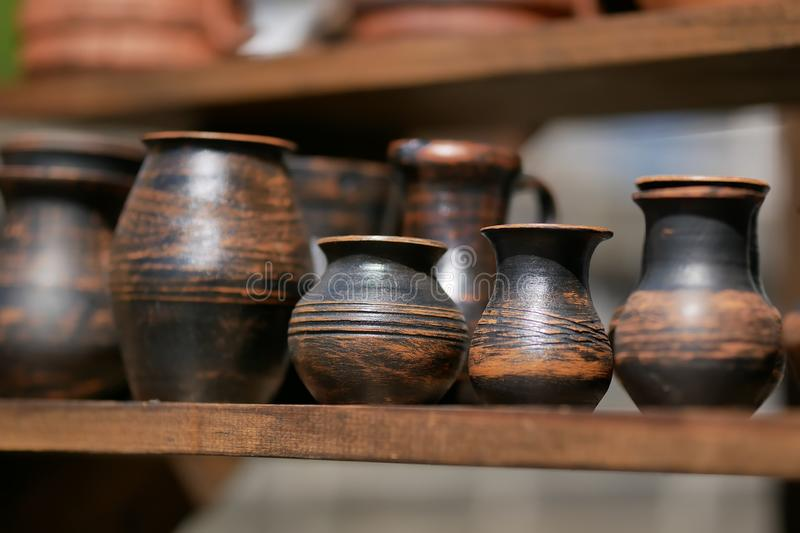handmade clay pots on wooden table. stock photography
