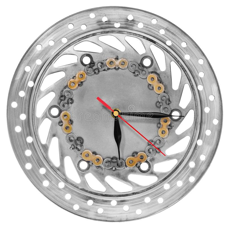 Handmade clock made of motorcycle parts. A clock face made of a. Brake disc decorated with hand-painted chain parts. Artistic object on a white background royalty free stock photo