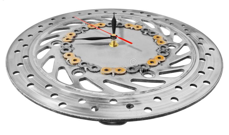 Handmade clock made of motorcycle parts. A clock face made of a. Brake disc decorated with hand-painted chain parts. Artistic object on a white background stock image