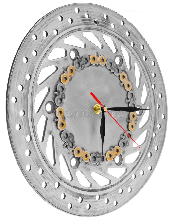 Handmade clock made of motorcycle parts. A clock face made of a. Brake disc decorated with hand-painted chain parts. Artistic object on a white background royalty free stock photos