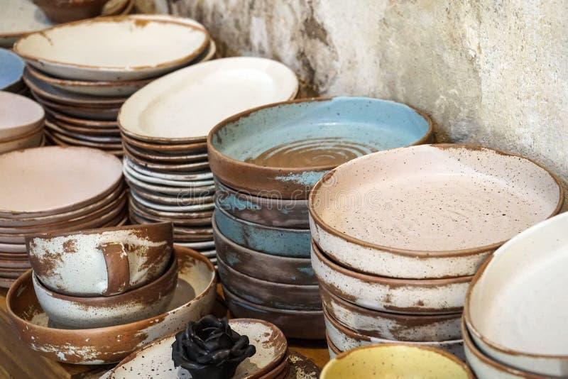 Handmade color ceramic porcelain dinnerware plates dishes cups chopsticks set. S royalty free stock photo