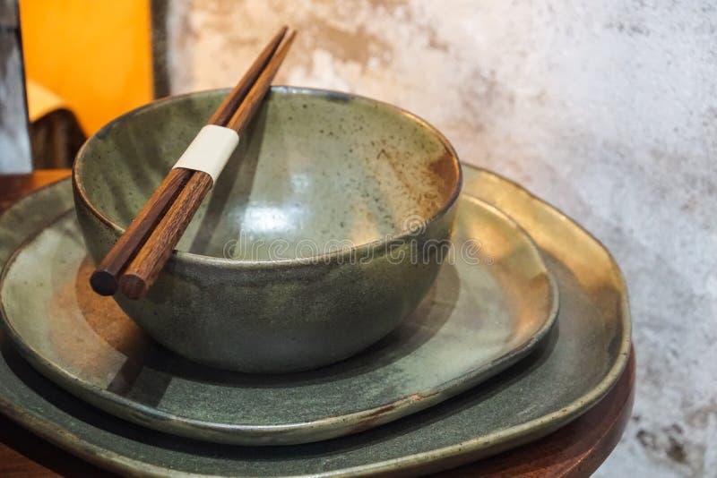 Handmade color ceramic porcelain dinnerware plates dishes cups chopsticks set. S stock image