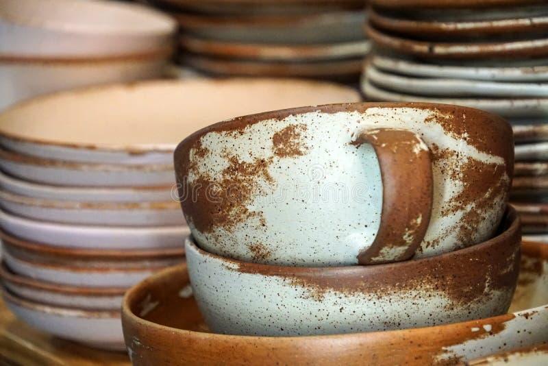 Handmade color ceramic porcelain dinnerware plates dishes cups chopsticks set. S stock images
