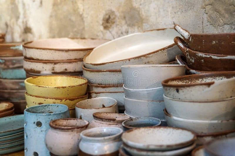 Handmade color ceramic porcelain dinnerware plates dishes cups chopsticks set. S royalty free stock image