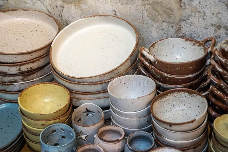 Handmade color ceramic porcelain dinnerware plates dishes cups chopsticks set. S stock photos