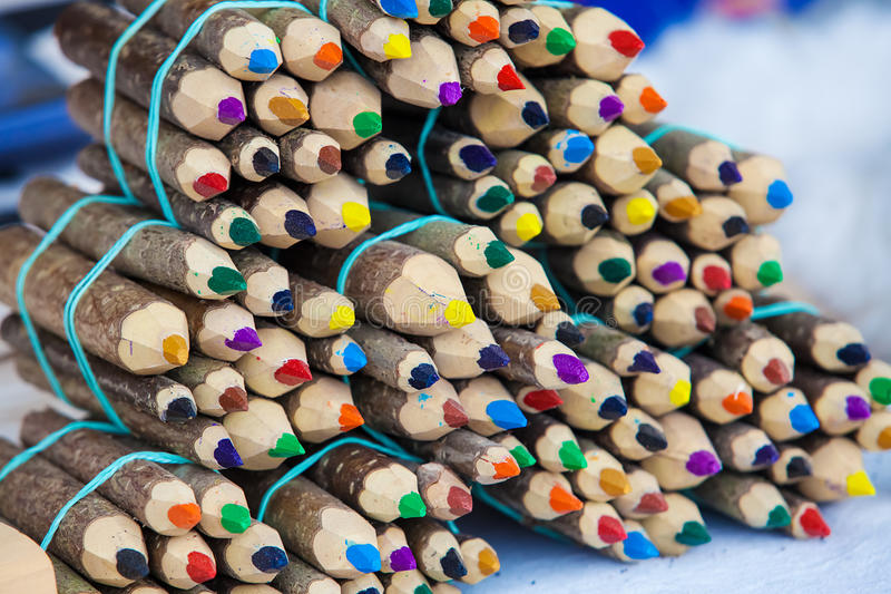 Handmade color pencil from wooden logs stock photos