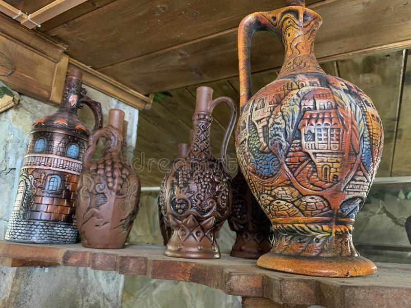 Handmade colored vases, clay or porcelain for market trading stock images