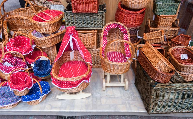 Handmade colorful wicker baskets and cradle royalty free stock images