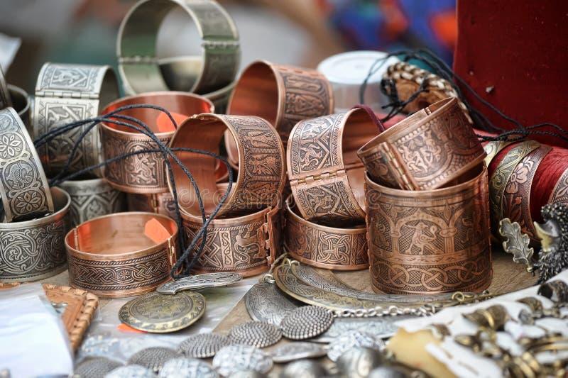 Handmade copper bracelets. Brass jewelry at handicraft market royalty free stock photography