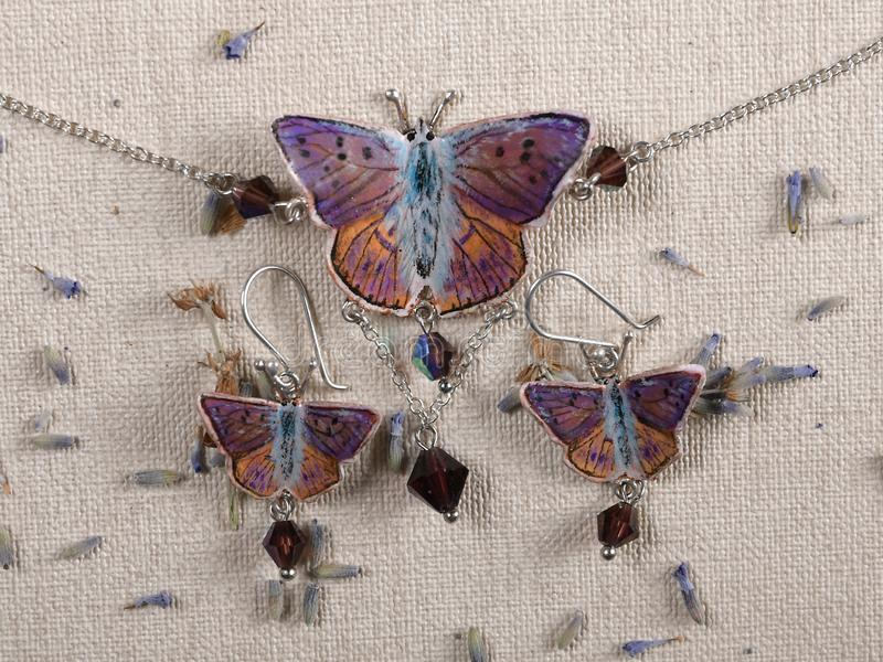 Handmade copper jewelry butterfly from the genus Lycaena alciphron stock photos