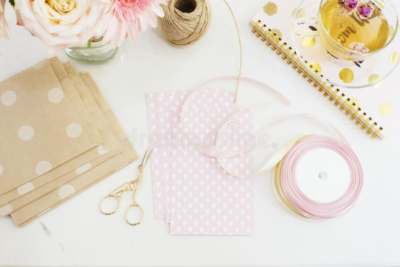 Handmade, craft concept. Handmade goods for packaging - twine, ribbons. Feminine workplace concept. Freelance fashion femininity w. Orkspace in flat lay style stock photo