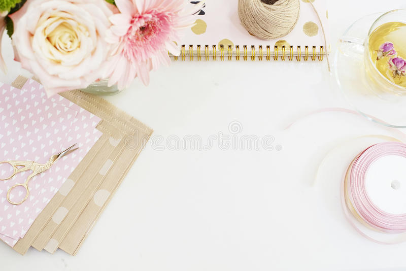 Handmade, craft concept. Handmade goods for packaging - twine, ribbons. Feminine workplace concept. Freelance fashion femininity w. Orkspace in flat lay style stock image