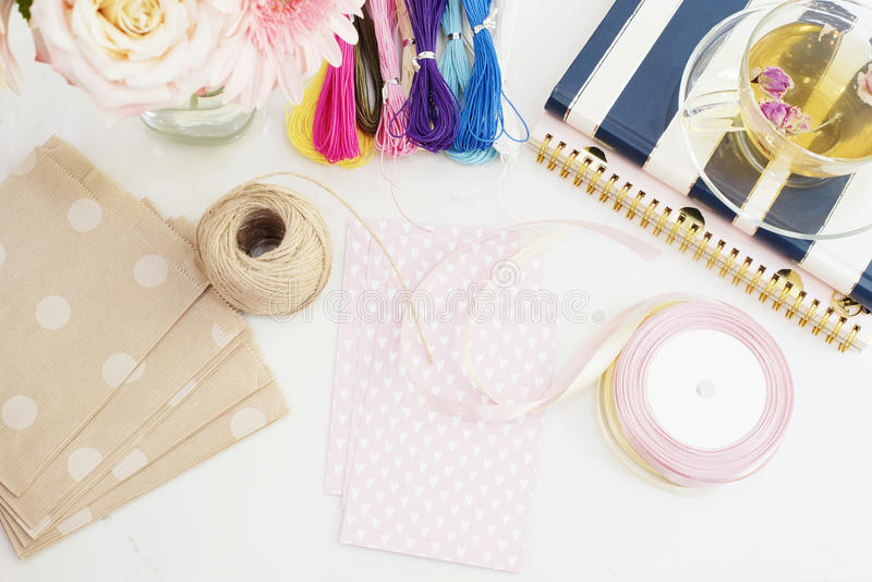 Handmade, craft concept. Materials for making string bracelets and handmade goods packaging - twine, ribbons. Feminine workplace c royalty free stock images