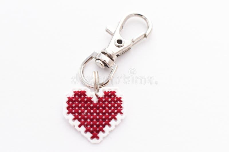 Handmade Cross Stitch Keychain Red Heart royalty free stock photos