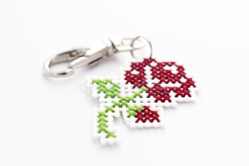 Handmade Cross Stitch Keychain Red Rose stock images