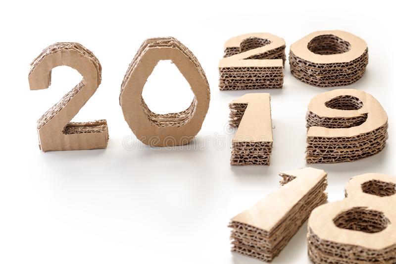 2019 ,18 and 20 handmade 3D numbers made of reused cardboard paper, on white background. New year concept. 2019 ,18 and 20 handmade 3D numbers made of reused royalty free stock photo