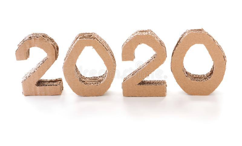 2020, handmade 3D numbers made of reused cardboard paper, on white background. New year environmental decoration concept. 2020, handmade 3D numbers made of stock photography