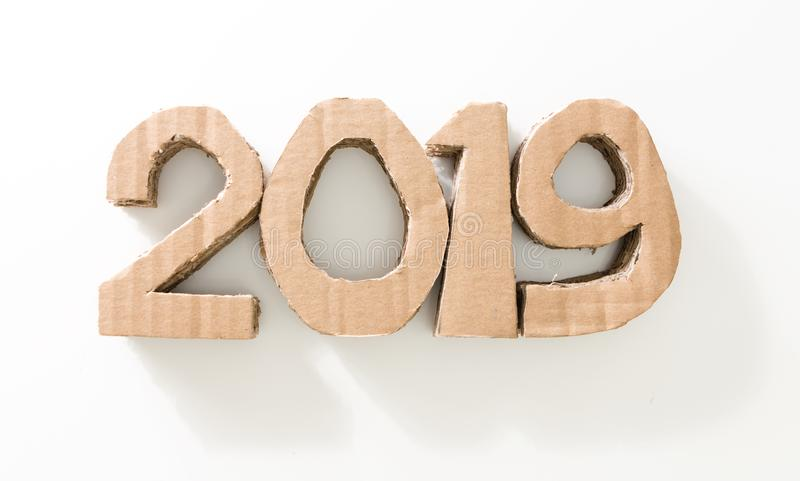 2019, handmade 3D numbers made of reused cardboard paper, on white background. New year environmental decoration concept. 2019, handmade 3D numbers made of stock photos