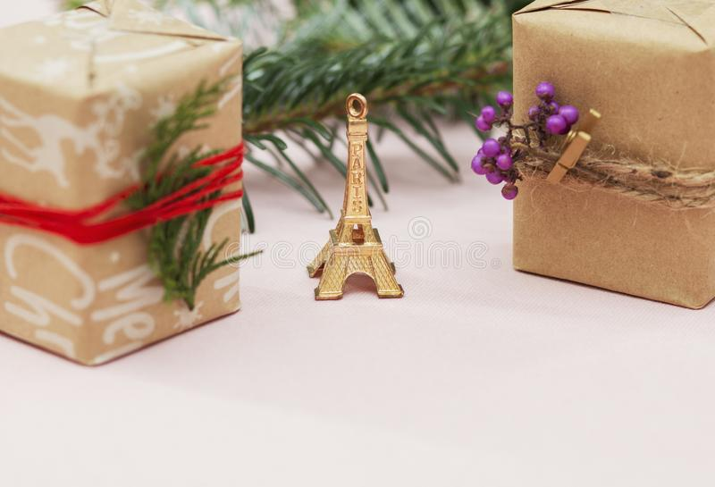 Handmade decorations for the holiday, Eiffel Tower gift wrapping, girl packs a gift, gift to a loved one. Handmade decorations for the holiday, gift wrapping royalty free stock images