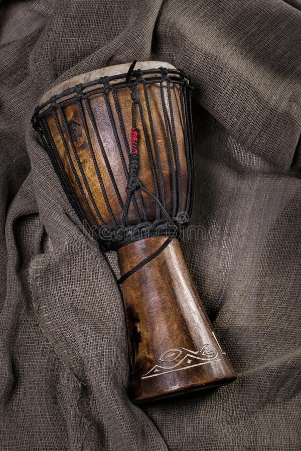 African djembe drum hand carved lying on canvas fabric royalty free stock photos
