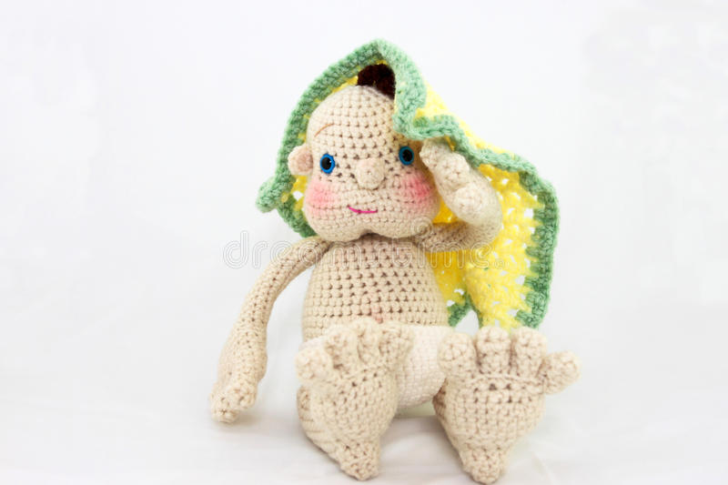 Handmade Doll With Blanket. A homemade crochet toy doll with his blanket photographed on a light background royalty free stock image