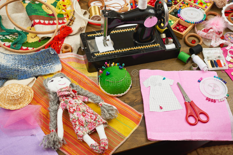 Handmade doll and clothing pattern, sewing accessories top view, seamstress workplace, many object for needlework, embroidery and. Handicraft royalty free stock photos