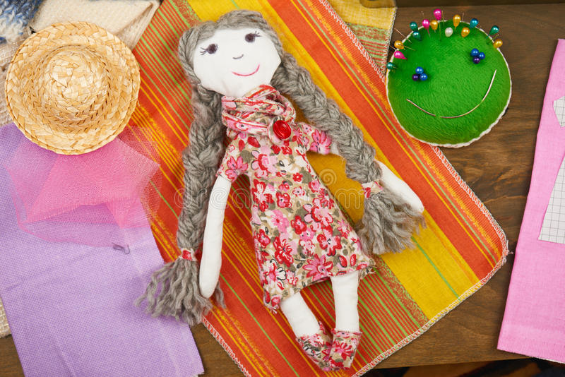 Handmade doll, sewing accessories top view, seamstress workplace, many object for needlework, embroidery, handmade and handicraft stock image