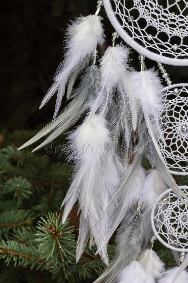 Handmade dream catcher with feathers threads and beads rope hanging royalty free stock photo