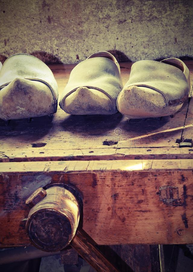 Dutch wooden clogs made by a skilled carpenter in the carpentry stock photos