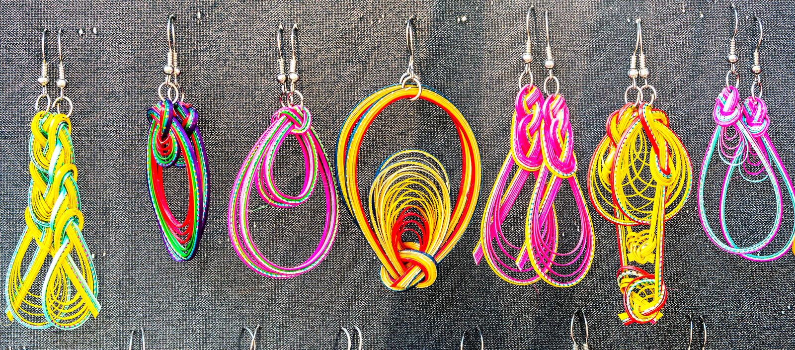 Handmade earrings with different shapes and colors royalty free stock photo
