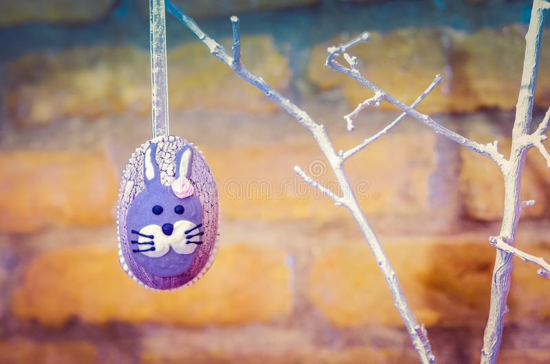 Handmade easter egg decoration with green leaves royalty free stock photography