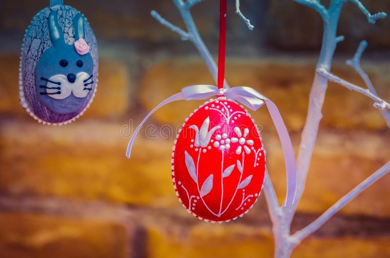 Handmade easter egg decoration with green leaves stock photos