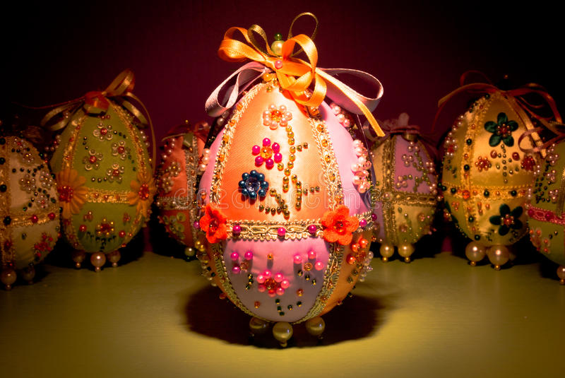 Handmade Easter eggs. Handmade cloth Easter eggs filled with beads and bijoux stock photography