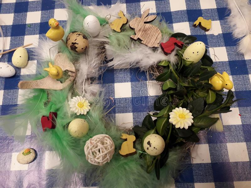 Handmade easter wreath with feathers and rabitts royalty free stock images