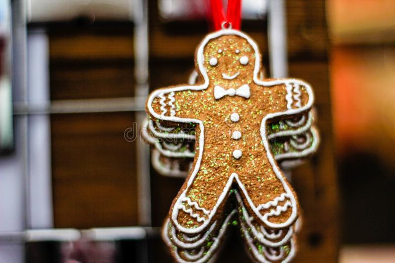 Handmade Eco style Christmas decorations with gingerbread man. A view of an original natural decorations for Christmas and New Year. Indoor decor for Christmas stock images
